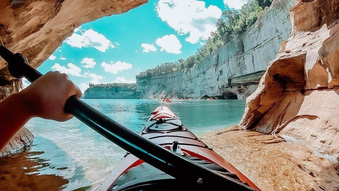 Paddling through one of the sea caves in the Pictured Rocks National Lakeshore. PC: Instagrammer @kaylanreid